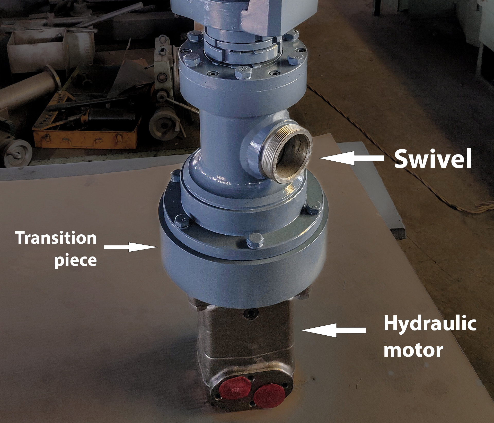Swivel and hydraulic motor adapter